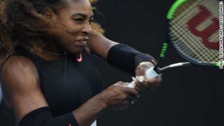 Serena Williams of the US hits a return against Venus Williams of the US during the women's singles final on day 13 of the Australian Open tennis tournament in Melbourne on January 28, 2017. / AFP / PAUL CROCK / IMAGE RESTRICTED TO EDITORIAL USE - STRICTLY NO COMMERCIAL USE        (Photo credit should read PAUL CROCK/AFP/Getty Images)
