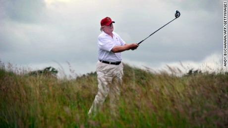 US tycoon Donald Trump plays a stroke as he officially opens his new multi-million pound Trump International Golf Links course in Aberdeenshire, Scotland, on July 10, 2012. Work on the course began in July 2010, four years after the plans were originally submitted.  AFP PHOTO / Andy Buchanan        (Photo credit should read Andy Buchanan/AFP/GettyImages)