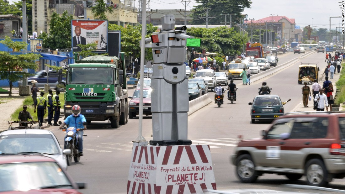 In 2014 two rudimentary androids were installed at a busy intersection in Kinshasa, Democratic Republic of Congo. Designed by the Kinshasa Higher Institute of Applied Technique, known as ISTA, the two prototypes were fitted with four cameras which recorded traffic flow. Video was fed back to the police for analyze.<br />