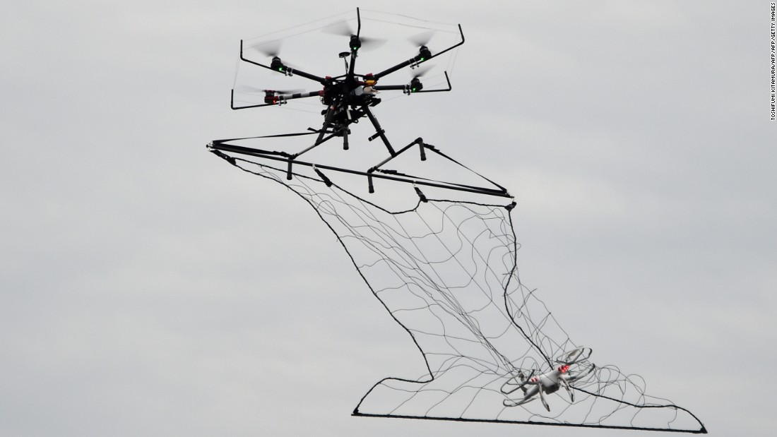 "In 2015 Tokyo Metropolitan Police unveiled a drone capable of taking out other drones, capturing them in a net. The police adapted current drone technology after a quadcopter carrying radioactive material was<a href=""http://edition.cnn.com/2015/04/24/asia/japan-prime-minister-radioaction-drone-arrest/""> flown onto the rooftop of Japanese Prime Minister Shinzo Abe's office</a> in April 2015."