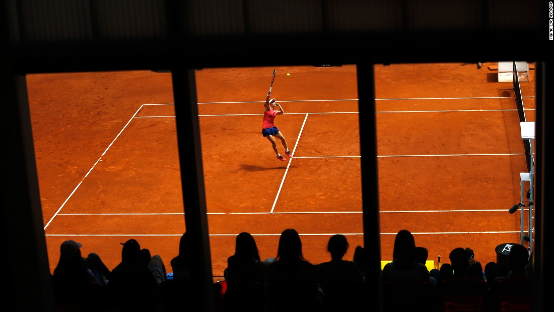 Samantha Stosur jumps for a shot during a match at the Madrid Open on Tuesday, May 9.