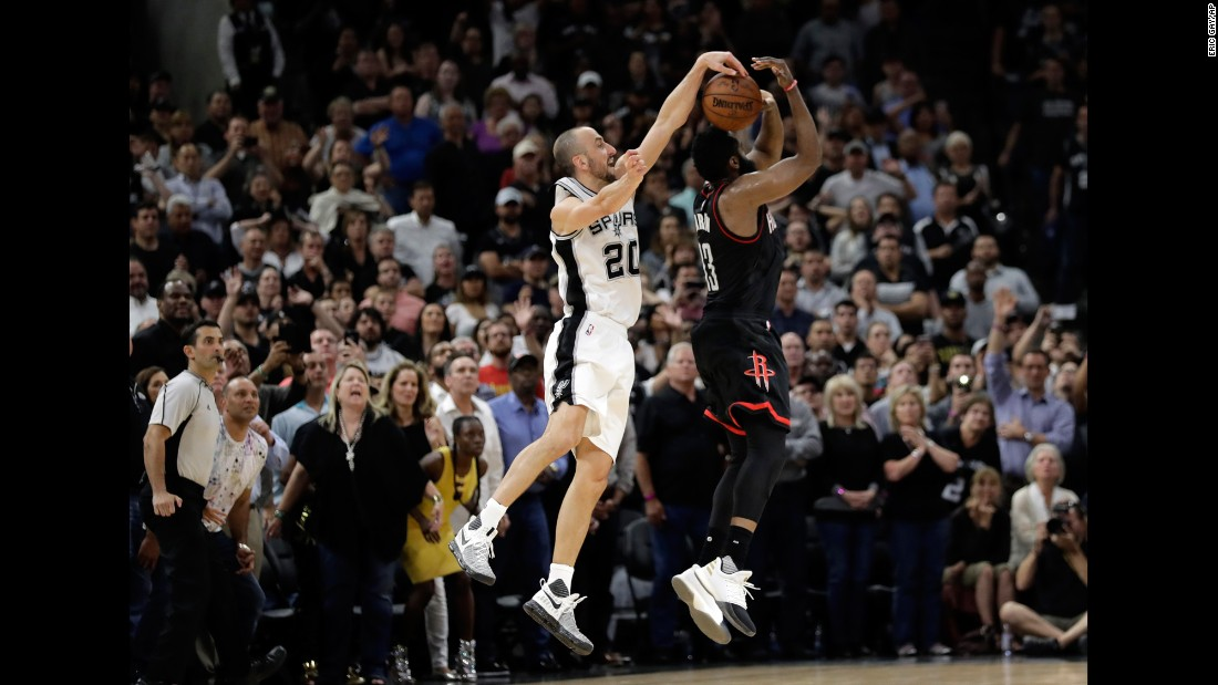 Manu Ginobili blocks James Harden as time expires, clinching a Game 5 playoff win for the San Antonio Spurs on Tuesday, May 9. The Spurs eliminated the Rockets one game later to advance to the NBA's Western Conference Finals.