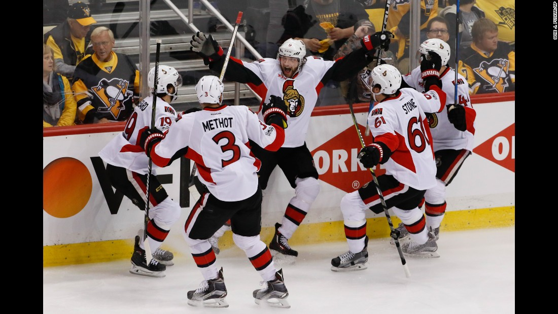 Ottawa's Bobby Ryan, center, is swarmed by his teammates after scoring an overtime goal to beat Pittsburgh in Game 1 of the NHL's Eastern Conference Final on Saturday, May 13.