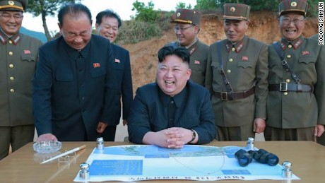 North Korean leader Kim Jong Un surrounded by officials on the day of the May 14 missile launch.