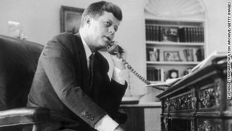 John F. Kennedy, the 35th president of the United States, making a telephone call.