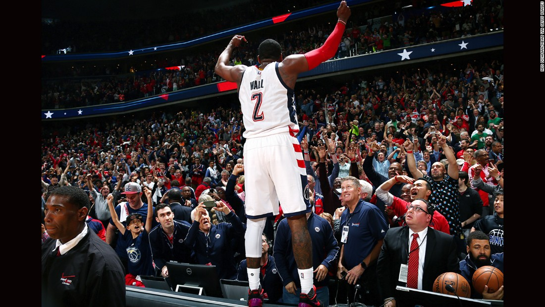 Washington point guard John Wall celebrates his team's Game 6 playoff victory against Boston on Friday, May 12. Wall hit the game-winning 3-pointer to force a deciding Game 7.