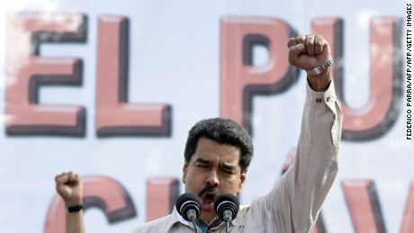 "Venezuelan President Nicolas Maduro raises his fist as he delivers a speech before supporters gathering outside the presidential palace in Caracas on March 12, 2015. The European Parliament called on Venezuela Thursday to release students and opposition figures ""arbitrarily detained"" during protests against left-wing Maduro. Maduro has launched a crackdown on the opposition, saying they are doing Washington's work in trying to oust him and other left-wing leaders in Latin America. Earlier this week, the United States imposed sanctions against Venezuela as Maduro moved closer to rule by decree.   AFP PHOTO / FEDERICO PARRA        (Photo credit should read FEDERICO PARRA/AFP/Getty Images)"