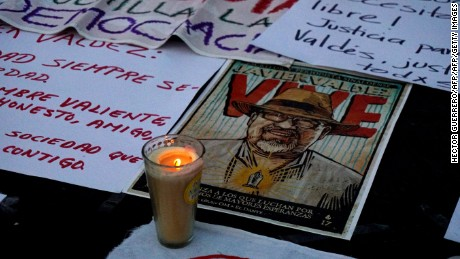 Journalists display signs against violence to journalists while protesting the recent murder of the of Mexican journalist Javier Valdez on May 16, 2017 in Guadalajara.              Mexico ranks third in the world for the number of journalists killed, after Syria and Afghanistan, according to the media rights group Reporters Without Borders (RSF)                    / AFP PHOTO / Hector Guerrero        (Photo credit should read HECTOR GUERRERO/AFP/Getty Images)