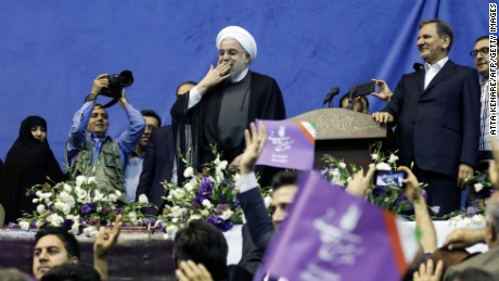 Rouhani blows a kiss to supporters at a rally in Tehran last week.