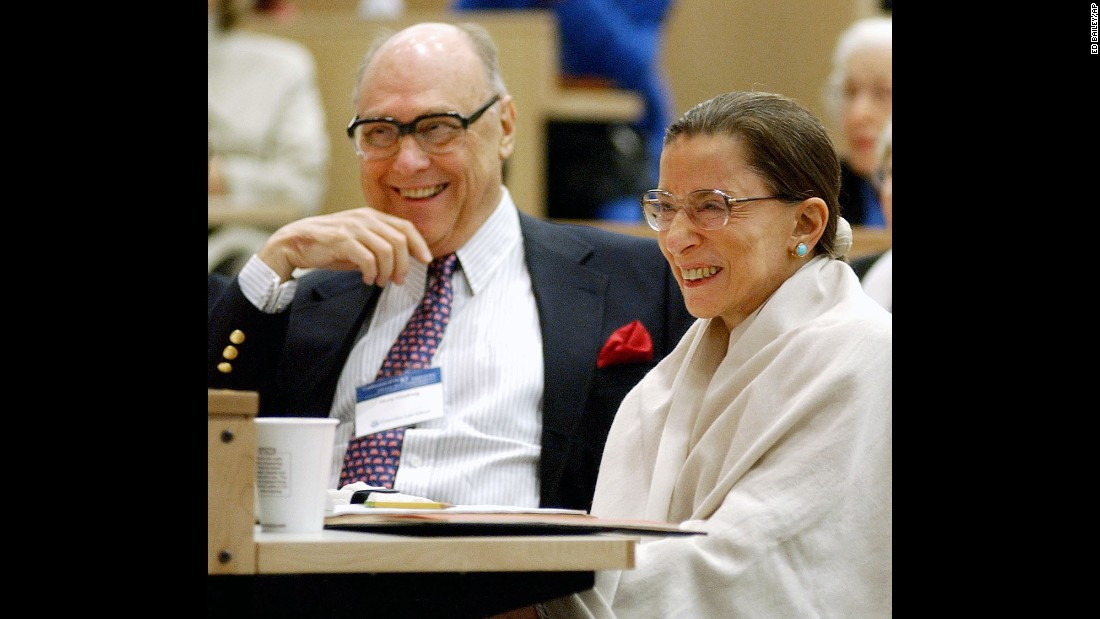 Ginsburg and her husband laugh as they listen to Supreme Court Justice Stephen Breyer speak at Columbia Law School in September 2003.