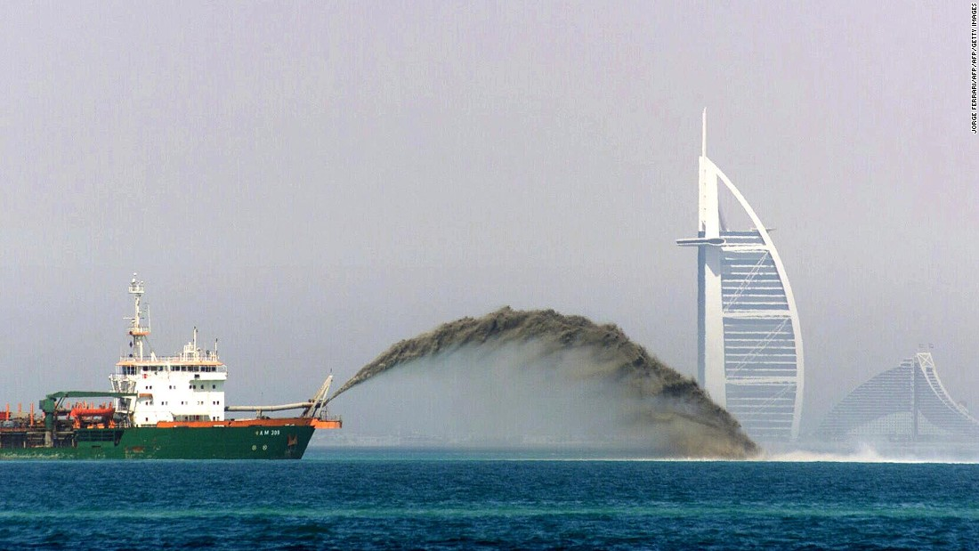A dredger barge pumps sand onto the sea bed three miles off the Dubai coast in 2002 during the construction of the Palm Jumeirah.