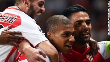 Monaco's French forward Kylian Mbappe (C) celebrates after scoring a goal during the French L1 football match Monaco (ASM) vs St Etienne (ASSE) on May 17, 2017, at the Louis II Stadium in Monaco. / AFP PHOTO / BORIS HORVAT        (Photo credit should read BORIS HORVAT/AFP/Getty Images)