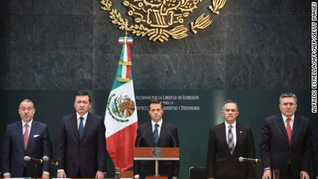 (L to R): Mexico's Attorney General Raul Cervantes, Interior Minister Miguel Osorio Chong and President Enrique Pena Nieto, and Mexico City Mayor Miguel Mancera and the head of the National Human Rights Commission Luis Raul Gonzalez, stand during a minute of silence for journalists killed in Mexico, during a special presidential message to the media pledging to strengthen mechanisms to guarantee the safety of reporters, at the Los Pinos Residence in Mexico City, on May 17, 2017.  In the last three months, three journalists have been killed in different parts of the country. And since 2000, more than 100 reporters have been killed, including 11 in 2016 alone. / AFP PHOTO / ALFREDO ESTRELLA        (Photo credit should read ALFREDO ESTRELLA/AFP/Getty Images)