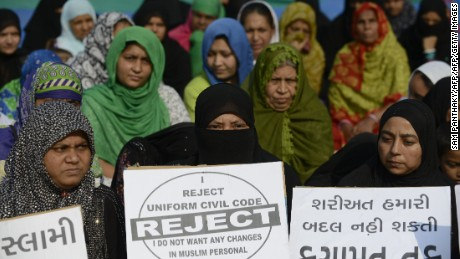 "Indian Muslim women participate in a rally to oppose the Uniform Civil Code (UCC) that would outlaw the practice of ""triple talaq"" in Ahmedabad on November 4, 2016. India's Prime Minister Narendra Modi's Hindu nationalist government has said it wants to replace the controversial practice of triple talaq, which allows Muslim men to divorce their wives instantly with a single word, with a new uniform civil code applicable to all religious groups.  / AFP / SAM PANTHAKY        (Photo credit should read SAM PANTHAKY/AFP/Getty Images)"