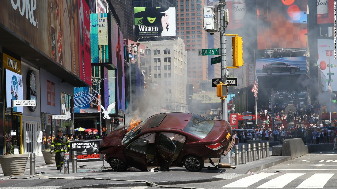 "A wrecked vehicle is on fire <a href=""http://www.cnn.com/2017/05/18/us/gallery/times-square-car-incident/index.html"" target=""_blank"">after hitting pedestrians in New York's Times Square</a> on Thursday, May 18. At least one person was killed, officials said, and nearly two dozen were injured. The driver is in custody, and city leaders said there was no indication that it was an act of terrorism."