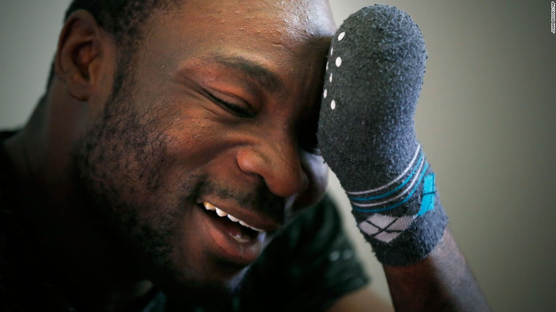 "Seidu Mohammed, a refugee from Ghana, smiles after he was granted asylum in Canada on Thursday, May 18. <a href=""http://www.cnn.com/2017/02/13/americas/refugees-flee-united-states-for-canada/"" target=""_blank"">He lost all his fingers to frostbite,</a> which he suffered while walking across the border from the United States."