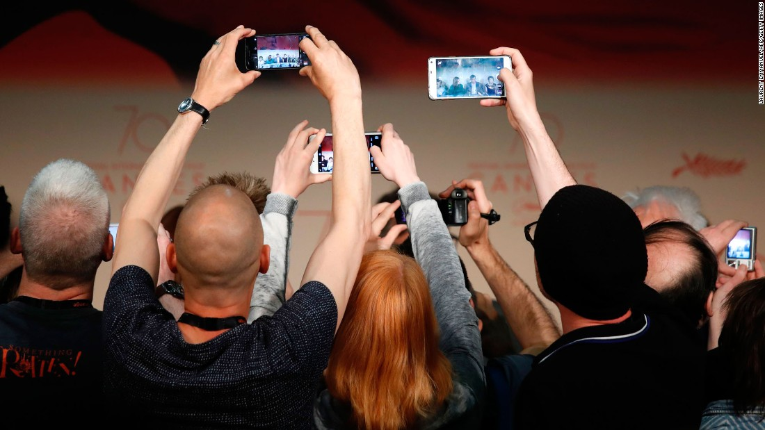 Journalists take photos of actress Julianne Moore and director Todd Haynes at the Cannes Film Festival in France on Thursday, May 18.