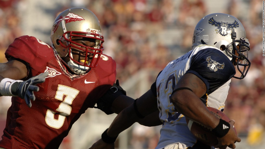 Rolle, as a Florida State University freshman safety, chasing Rice quarterback Joel Armstrong during a game in 2006. After his undergraduate career at the university, Rolle completed a Rhodes Scholarship at Oxford University, where he earned a master's degree in medical anthropology.