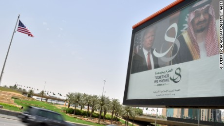 A giant billboard bearing portraits of President Donald Trump and Saudi Arabia's King Salman, is seen on a main road in Riyadh, on May 19, 2017.