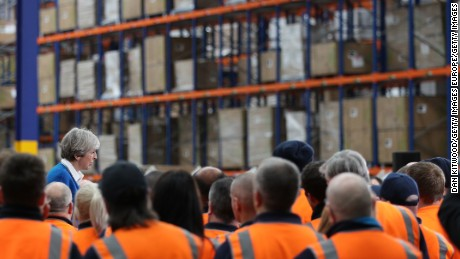 British Prime Minister Theresa May speaks to workers at a distribution center in Stoke-on-Trent.