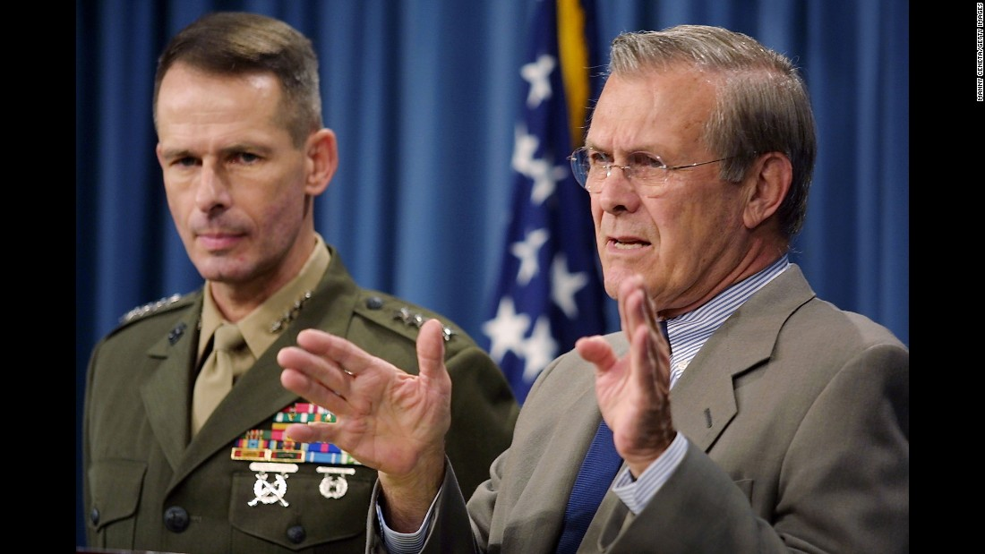 US Defense Secretary Donald Rumsfeld, right, speaks to the press during a Pentagon briefing on November 6, 2001. Rumsfeld said the United States had more than doubled the number of its troops based in Afghanistan. Other countries also contributed troops to the coalition.