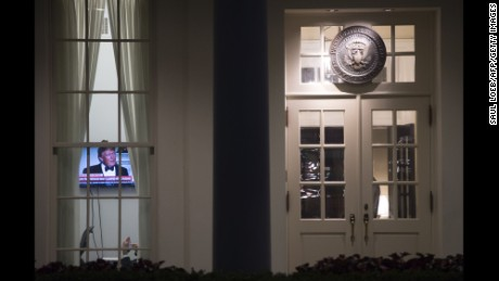 TOPSHOT - An image of US President Donald Trump appears on a television screen inside the West Wing of the White House in Washington, DC, May 15, 2017, shortly after the Washington Post reported Trump had revealed highly classified information to Russia's foreign minister and ambassador to the US during an Oval Office meeting last week.  / AFP PHOTO / SAUL LOEB        (Photo credit should read SAUL LOEB/AFP/Getty Images)