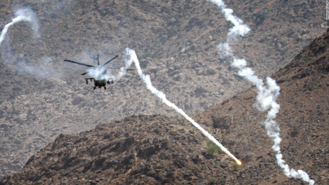 A coalition helicopter fires flares in Kuz Kunar, Afghanistan, on July 17, 2011.