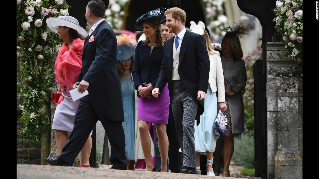 Britain's Prince Harry and other guests leave St. Mark's Church after the wedding ceremony.