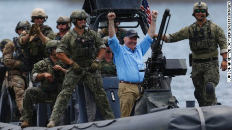 Tampa Mayor Bob Buckhorn, center, acknowledges onlookers after a mock operation during a special operations forces conference in May 2016. Photographer: Luke Sharrett/Bloomberg via Getty Images