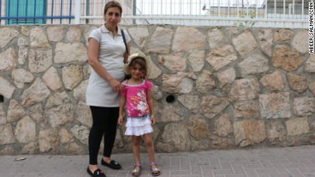 Yara Bahar, 36 and her daughter Rujina, 5, on the Jerusalem side of Checkpoint 300.