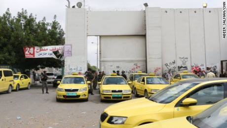 Taxis wait outside Checkpoint 300 in Bethlehem.