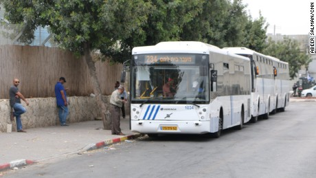 Busses wait at Checkpoint 300 to take Palestinians to Jerusalem.