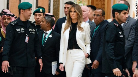 First Lady Melania Trump watches as President Donald Trump poses for photographs with leaders at Arab Islamic American Summit, at the King Abdulaziz Conference Center, Sunday, May 21, 2017, in Riyadh, Saudi Arabia. (AP Photo/Evan Vucci)