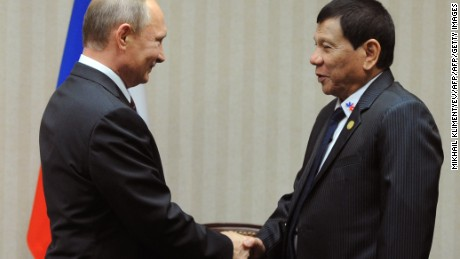 Russian President Vladimir Putin (L) meets Philippines President  Rodrigo Duterte on the sidelines of the APEC Summit in Lima, November 19, 2016.