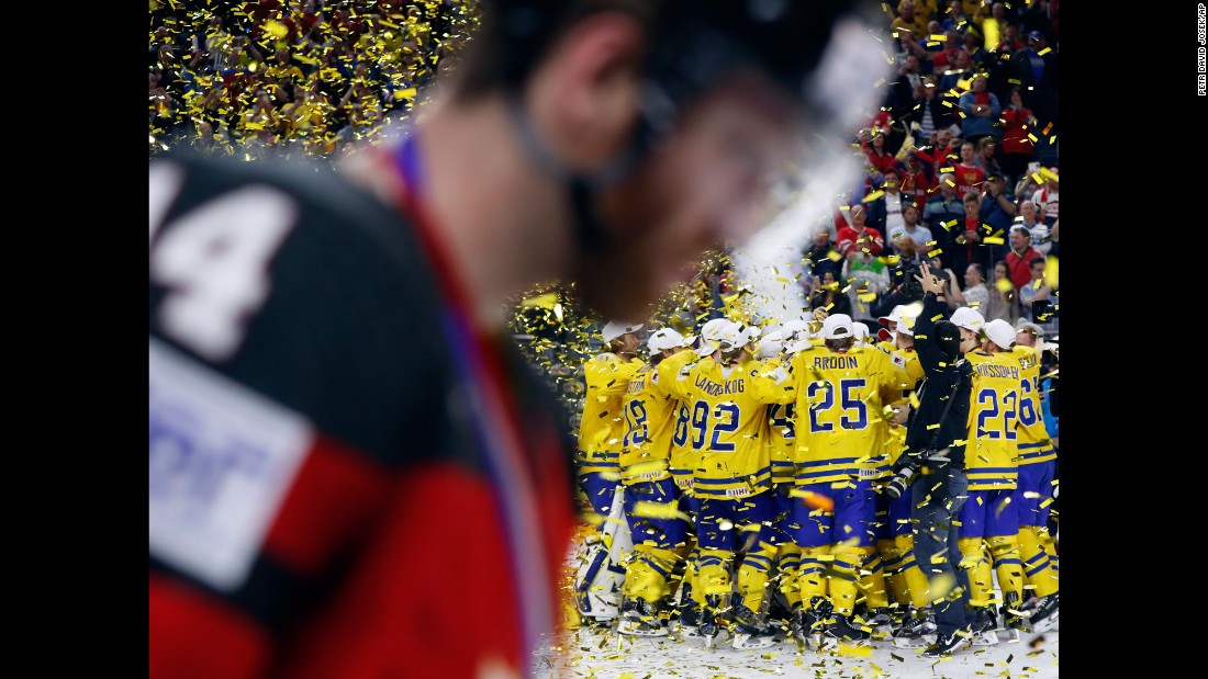 Swedish players celebrate after defeating Canada in the gold-medal game of the Ice Hockey World Championships on Sunday, May 21. Sweden won 2-1 after a penalty shootout.