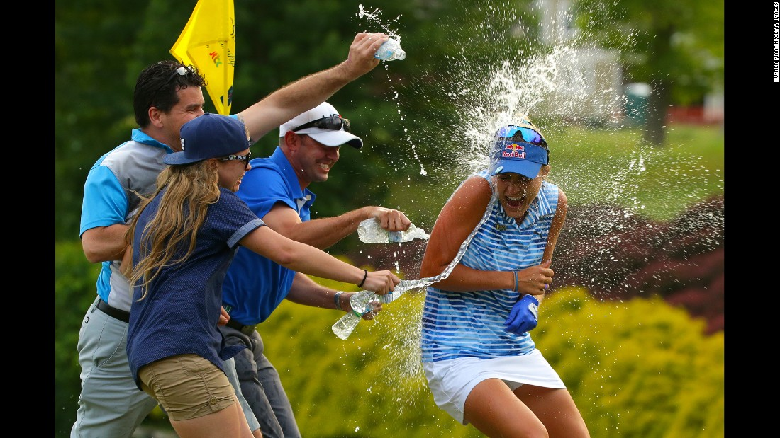 Lexi Thompson is sprayed with water on the 18th green after winning the Kingsmill Championship, an LPGA tournament in Williamsburg, Virginia, on Sunday, May 21. She went wire to wire and shot a tournament record 264 (20-under).