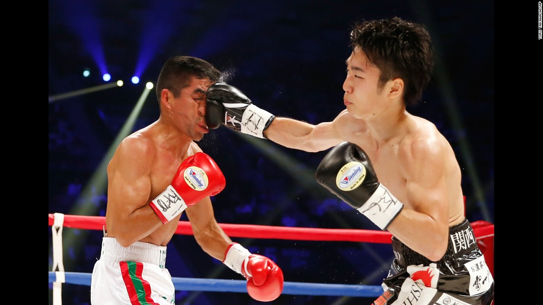 Shiro Ken lands a right hand against Ganigan Lopez during their title bout in Tokyo on Saturday, May 20. Ken won a majority decision to take home the WBC's light-flyweight belt.