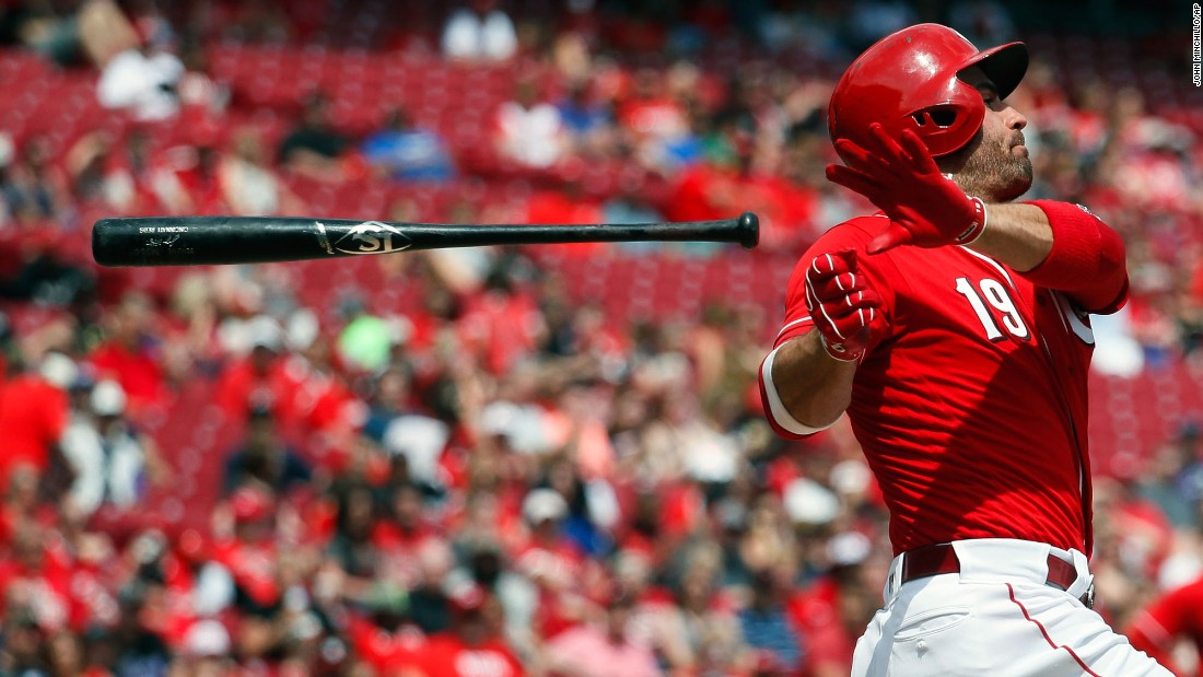 Cincinnati's Joey Votto loses his bat during a swing on Sunday, May 21.