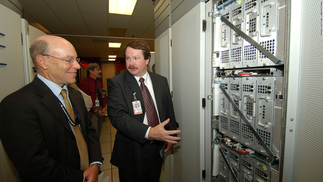 This US-built supercomputer was the first to break the 1 teraflop barrier (performing 1 trillion calculations per second). It was the fastest supercomputer in the world from 1997 to 2000, and also the first supercomputer installation to use more than 1 megawatt of power.<br /><br />Pictured here, VP Rick Stulen and Intel designer Stephen Wheat look at the innards of an ASCI Red rack. <br />