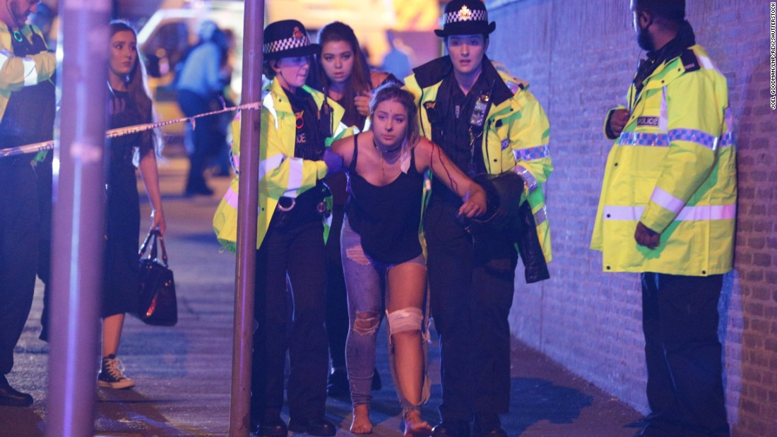 Police help someone after the attack at Manchester Arena on Monday, May 22.