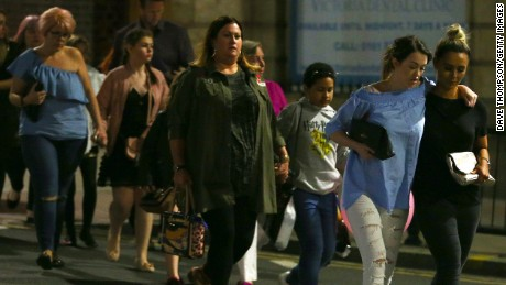 MANCHESTER, ENGLAND - MAY 23: Members of the public are escorted from the Manchester Arena on May 23, 2017 in Manchester, England.  An explosion occurred at Manchester Arena as concert goers were leaving the venue after Ariana Grande had performed.  Greater Manchester Police have confirmed 19 fatalities and at least 50 injured. (Photo by Dave Thompson/Getty Images)