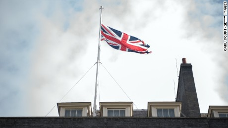 LONDON, ENGLAND - MAY 23:  The Union flag flies at half mast in Downing Street on May 23, 2017 in London, England. Prime Minister Theresa May has held a COBRA meeting this morning following a suicide attack at Manchester Arena as concert goers were leaving the venue after Ariana Grande had performed. Greater Manchester Police have confirmed the explosion as a terrorist attack with 22 fatalities and 59 injured.  (Photo by Carl Court/Getty Images)