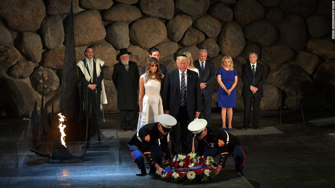 With the help of US Marines, Trump and his wife lay a wreath at Yad Vashem.