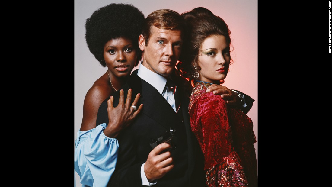 "English actor Roger Moore is flanked by Gloria Hendry, left, and Jane Seymour in this photo from the James Bond movie ""Live and Let Die"" in 1973. Moore, who portrayed Bond in seven films, <a href=""http://www.cnn.com/2017/05/23/entertainment/roger-moore-dies/"" target=""_blank"">died Tuesday, May 23,</a> at the age of 89."