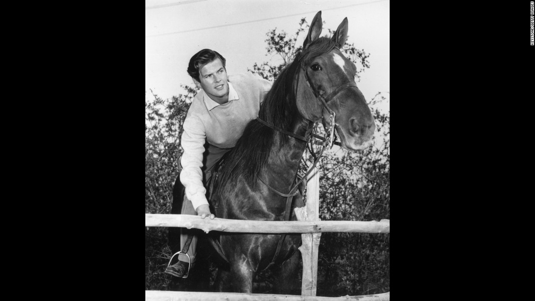 "Moore rides a horse in Hollywood circa 1955. He moved to the United States in 1953 and made his American television debut in the Hallmark Hall of Fame's production of ""Julius Caesar."""