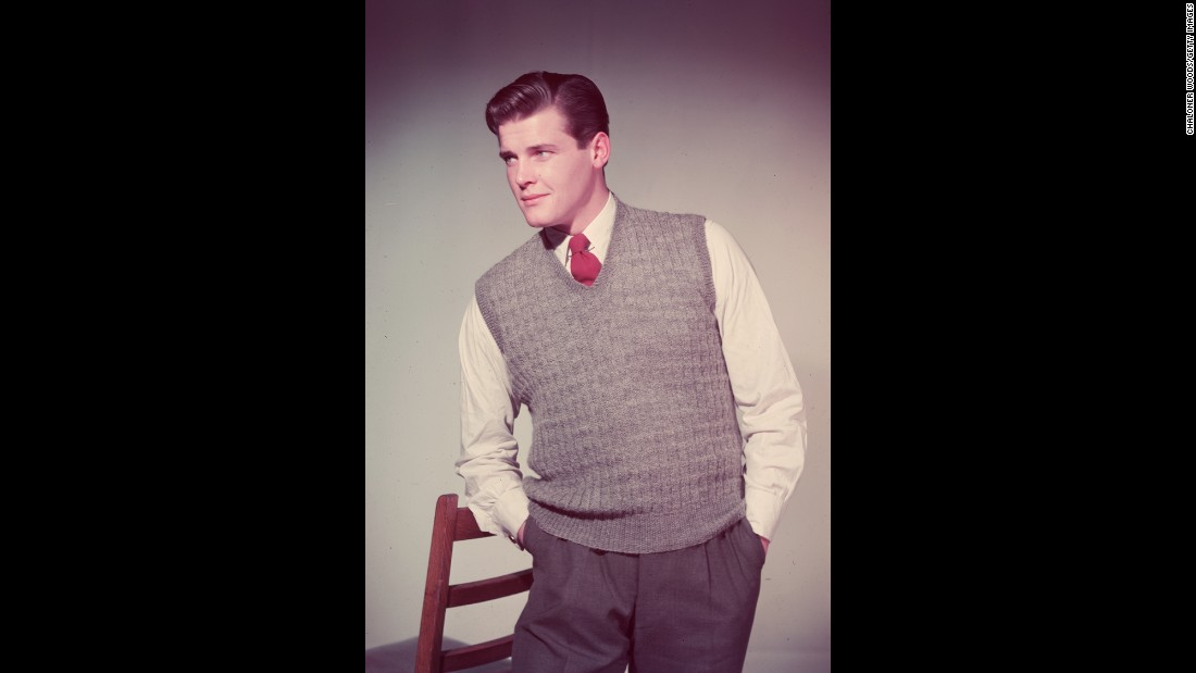 Moore wears a sweater in his modeling days, before he found fame in his acting career.