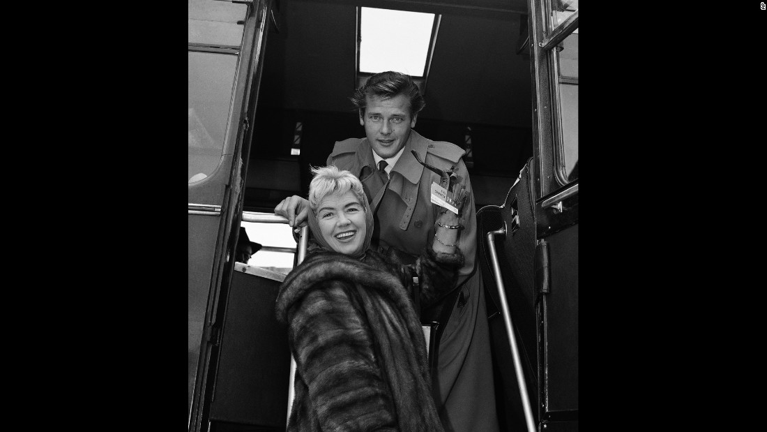 Moore and his wife at the time, singer Dorothy Squires, prepare to leave London after a two-week vacation in 1959. Moore was married four times.