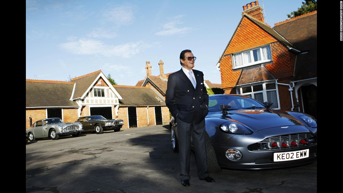 Moore stands beside an Aston Martin during a photo shoot in Milton Keynes, England, in 2008.