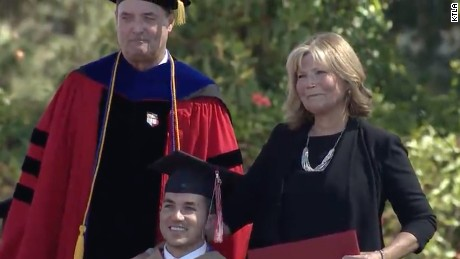 Mom gets a degree, too, after attending every grad class with quadriplegic son