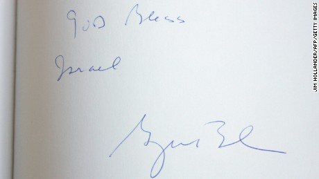 "A note reading, "" God Bless Israel, George Bush"" is seen on the Yad Vashem Holocaust memorial' guest book during a visit by US President George W. Bush in Jerusalem, 11 January 2008."